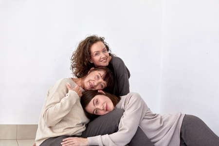 Mother and adult daughters in studio white background Stockfoto