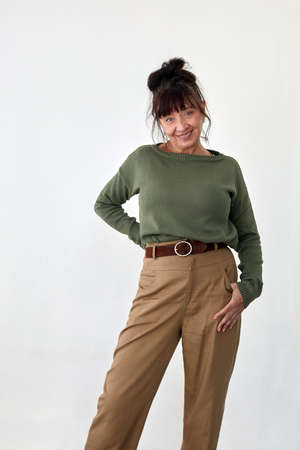 Delighted middle aged woman in trendy clothes