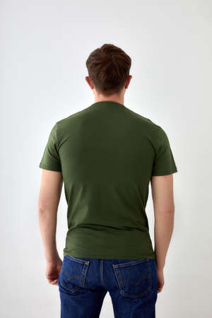 Faceless man in casual t shirt standing on white background