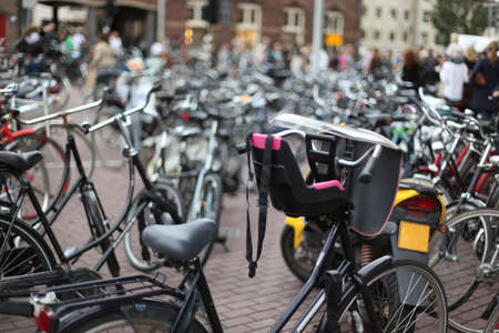 Collection of bicycles parked in city street