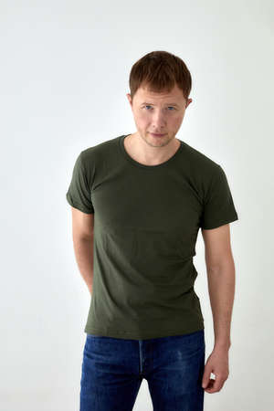 Handsome man in casual outfit standing on white background Stockfoto