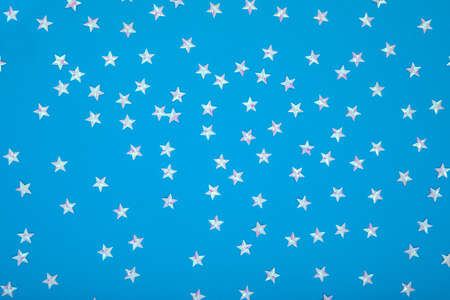Blue background with shiny iridescent pearl stars 스톡 콘텐츠