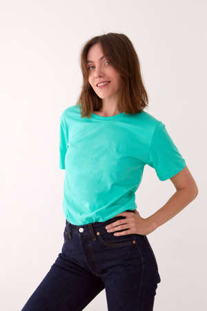Smiling woman in casual outfit standing in studio