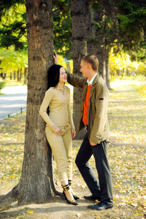 Couple in autumn park photo