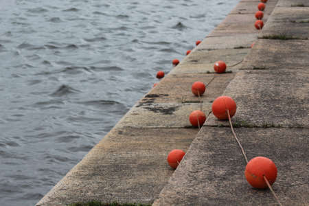 buoys: red buoys on the waterfront Stock Photo