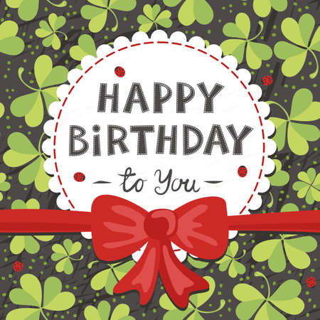 red clover: red bow on clover meadow with ladybugs birthday card with wishes in Angielski on dark background