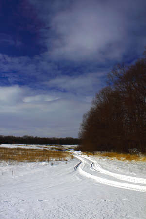 Photo of road in the winter on a snow field photo