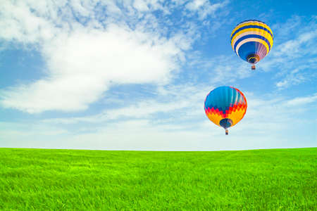 Photo of balloons in the sky over wheat field Reklamní fotografie