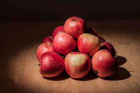 Photo of apples in a ray of light