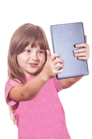 The childs photo with the tablet computer