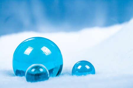Ice spheres on snow (white fur)