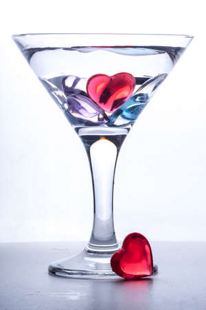 photo of a glass of the martini decorated with multi-colored hearts Reklamní fotografie