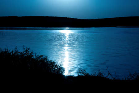 Photo of the moonlight reflected in the lake