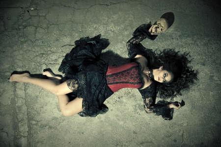 Devil girl on floor Banco de Imagens