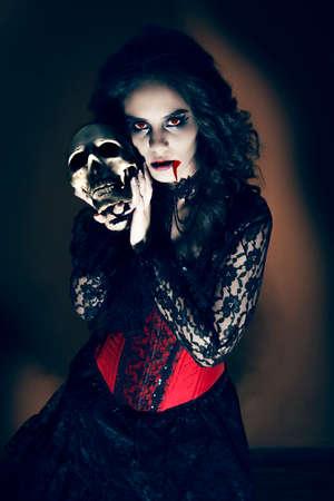 Devil girl with skull Banco de Imagens