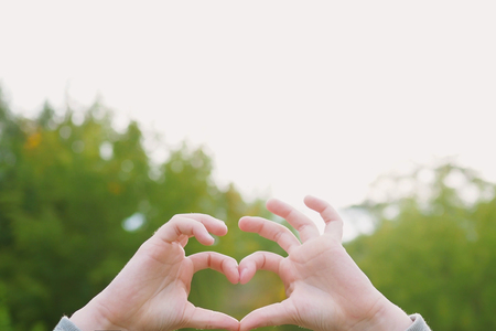 Child hands with a heart shaped. Healthy, happy childhood concept. Stockfoto