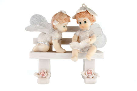 Figurines of children reading a book on a white background photo