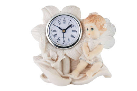 Girl figurine with a clock on white background photo