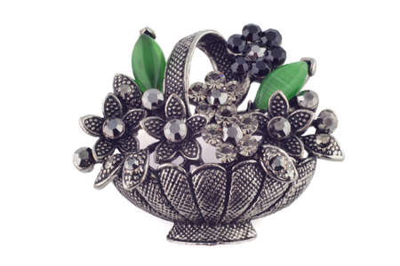 basket of flowers brooch with emeralds on a white background photo