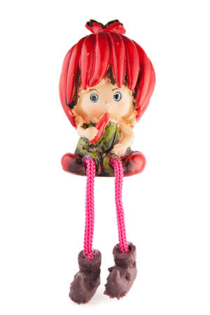 isolated figurine girl with pepper photo
