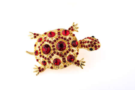 shiny brooch turtle on a white background photo
