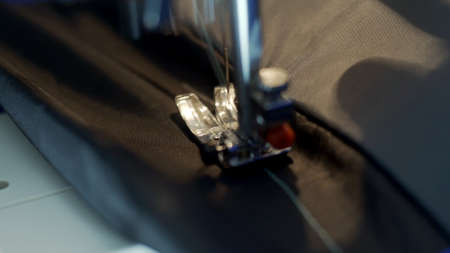 Close-up of sewing machine needle rapidly moves up and down. Foto de archivo - 140128389