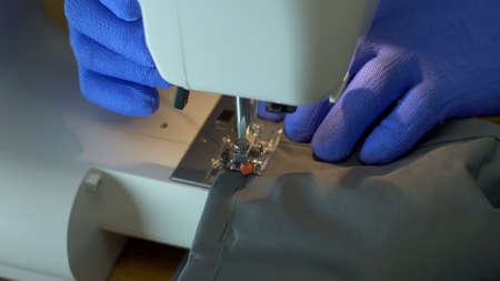Close-up of sewing machine needle rapidly moves up and down. Banco de Imagens
