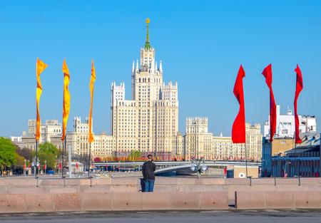 kotelnicheskaya embankment: Skyscraper on Kotelnicheskaya Embankment in Moscow and a young man looking at her