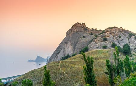 sudak: Rocks on the seashore on sunset Stock Photo