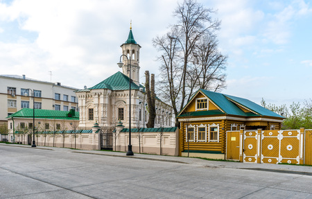 Apanaevskaya Mosque and the old wooden house in Kazan, Russia