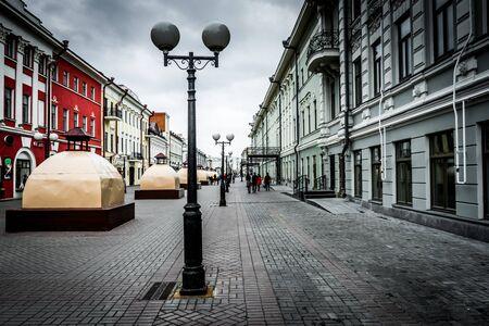 Lanterns on the main pedestrian street of Bauman in Kazan, Russia. Urban High Contrast Desaturated Look. Cross processed photo