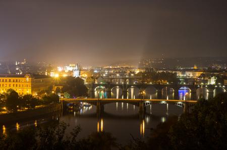 Bridges of Prague at night. Manesov Bridge, Charles Bridge, the Legion Bridge. Czech Republic
