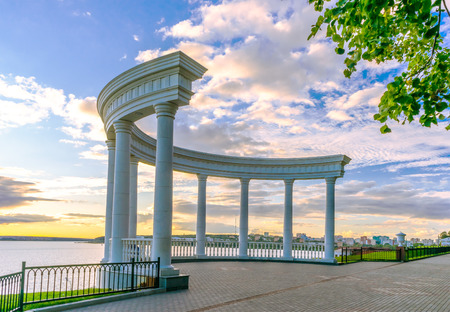 Rotunda on the embankment on a warm evening before sunset. Izhevsk, Russia