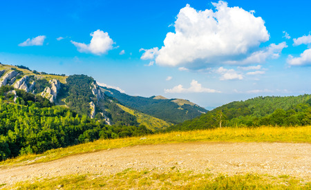 Clouds over the Crimean mountains covered with forest. View from the top of the Demerdzhi mountain in summer. Russia, the Crimea