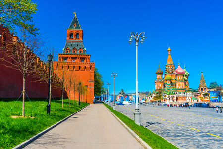 The Konstantin-Elenin Tower of the Moscow Kremlin and St. Basils Cathedral on a spring day. Russia