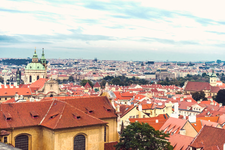 Beautiful views of Prague's tiled roofs and the Cathedral of St. Mikulas.