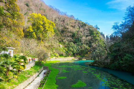 View of a beautiful pond in the mountains in early spring 스톡 콘텐츠