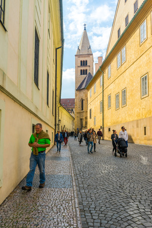 Czech Republic, Prague - September 20, 2017. Narrow street leading to the Basilica of St. George in Prague Castle Редакционное