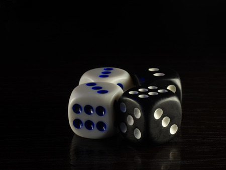 Table gambling with dice in the evening with dim light on a dark background.