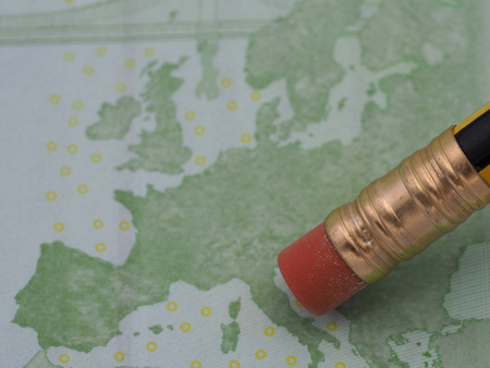 A high resolution image of a pencil eraser that is about to erase the Italian peninsula from a 100 euro bill.