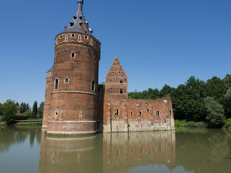 A medieval castle surrounded by water in Beersel, Belgium.