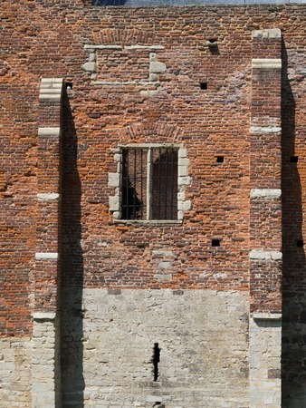 A picture of a brick castle wall.