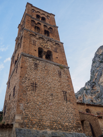 A close up of the bell tower of the church of Moustiers-Sainte-Marie.
