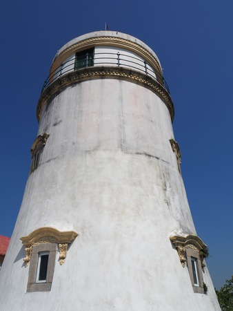 A front view of the lighthouse at the Guia Fortress in Macau.