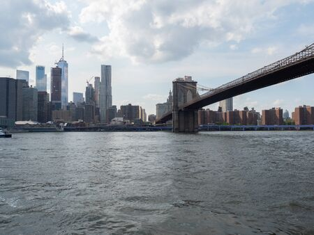 View of Manhattan and the East River from Brooklyn. Фото со стока