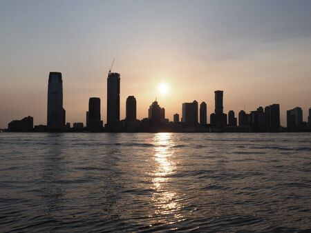 The Jersey City skyline during sunset as seen from Manhattan.