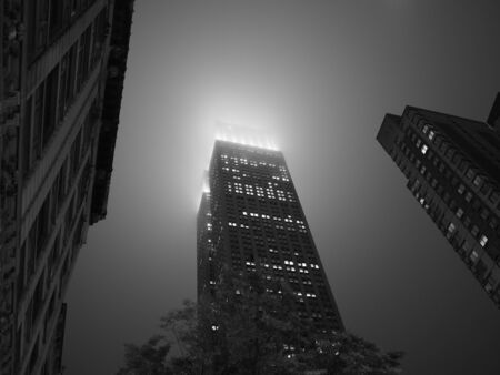 New York, USA - May 29, 2019: Monochrome image of the Empire State Building, late at night and covered in thick fog.