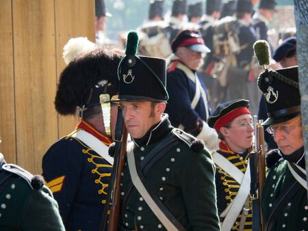 Waterloo, Belgium - June 18 2017: Several figurants dressed in 19the century military equipment during the re-enactment of the battle at Waterloo. 에디토리얼