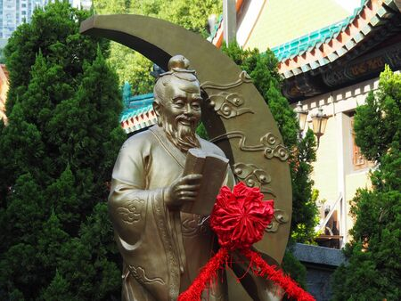 Kowloon, Hong Kong - November 03, 2017: An image of Yue Lao the god of marriage and love. The statue can be found in the Wong Tai Sin temple in Hong Kong. 新聞圖片