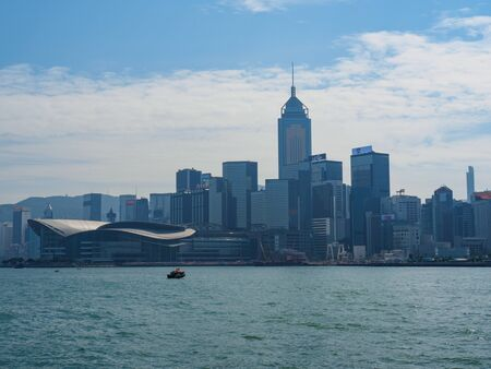 Central, Hong Kong - November 3, 2017: The skyline of Hong Kong with the convention and exhibition center on the left.